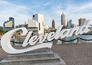 Cleveland sign in front of skyline