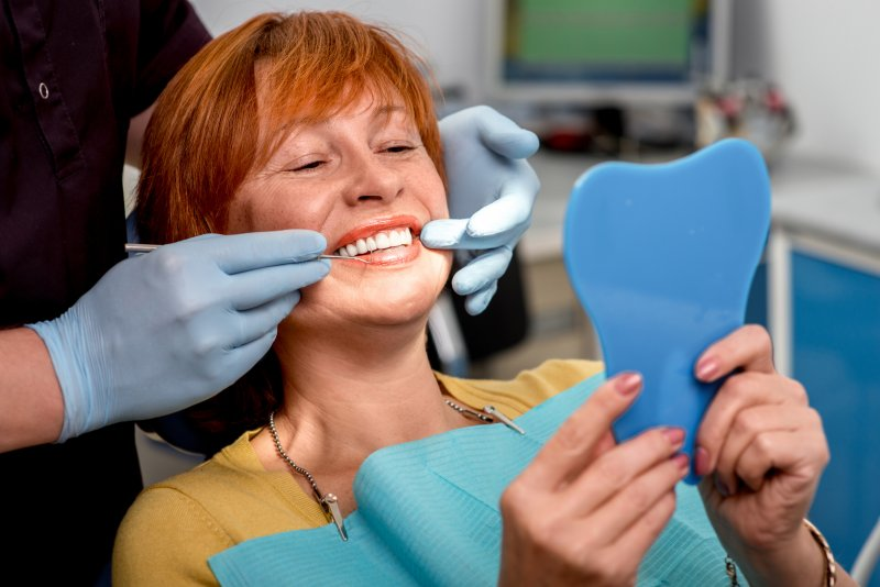 Woman with dental implants in Middleburg Heights